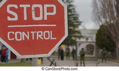 Stop sign near a military territory