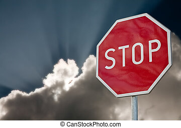 stop road sign on the blue sky background