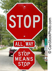 Stop sign with additional sign that says stop means stop - A...