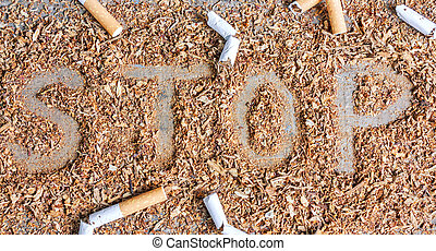 Stop smoking background with tobacco and cigarettes