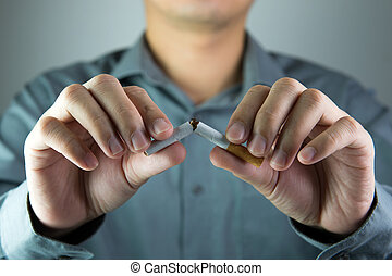Stop smoking message shown by breaking a cigarette