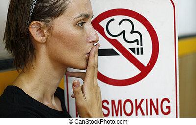 stop smoking - Lady smoking a non-smoking panel