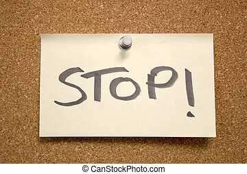 Stop! - A post it note with the word stop written on it,...