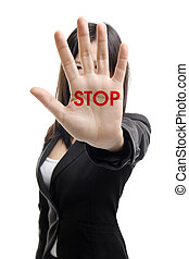 STOP - Serious business woman making stop sign over white...