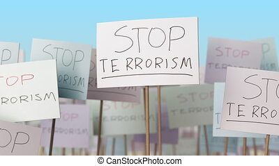 STOP TERRORISM placards at street demonstration. Conceptual loopable animation