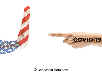 Stop the epidemic. Human hands colored in flag of USA and coronavirus - concept of spreading of virus