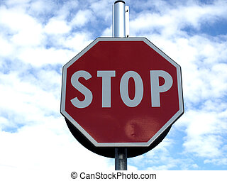 Stop traffic sign over blue sky with clouds
