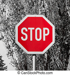 Stop traffic sign - white text in red octagonal shape. The...