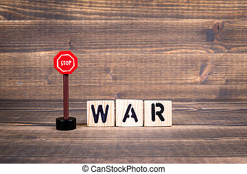 Stop War concept. Wooden letters with road sign