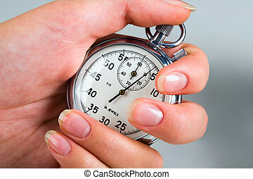 Portrait of female hand holding the stop-watch