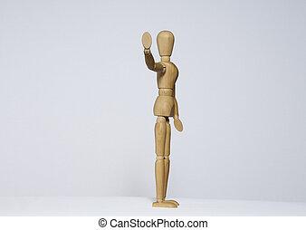 Wooden mannequin signals stop.