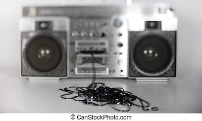 stopmotion of a fantastic looking retro ghetto blaster with cassette tape spilling out