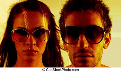 stopmotion of a man and woman wearing different retro sunglasses
