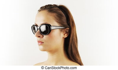 stopmotion of a pretty woman wearing different retro sunglasses