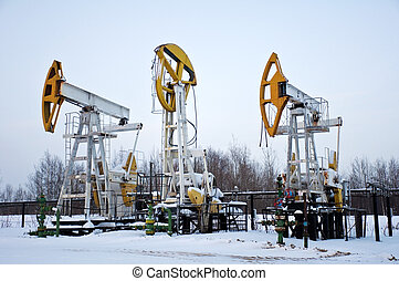 stopped pumpjacks - pumpjacks were stopped at the oil...