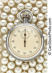 Stopwatch on white pearl