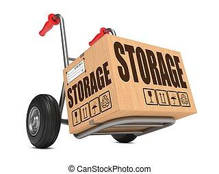 Cardboard Box with Storage Slogan on Hand Truck White Background.