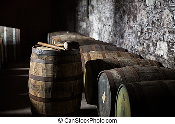 close up of old wooden barrel in wine cellar