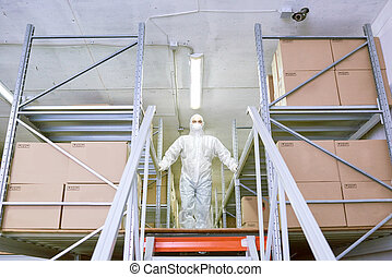 Storage employee standing in protective clothing