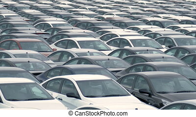 Storage Parking Lot of New Unsold Cars. There are many cars of different colors, blue, red, white, black. Saint-Petersburg, Russia. 2016