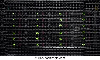 Storage racks with many hard drives in room of data center....