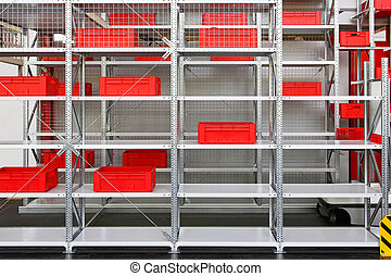 Modern shelving system with plastic red crates