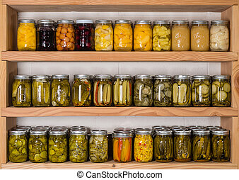 Storage shelves with canned food - Storage shelves in pantry...