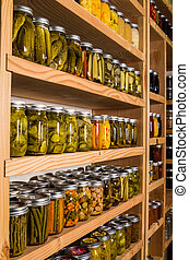 Storage shelves with canned goods - Canned goods on wooden ...