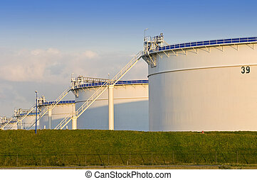 Oil storage tanks in the evening light