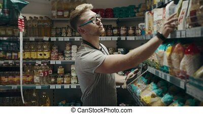 Store assistant using tablet while making revision of goods