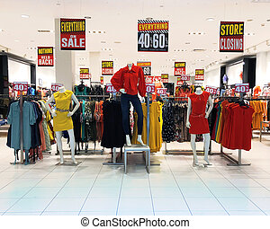 Store Closing Clothing Sale - A store mall has various ...