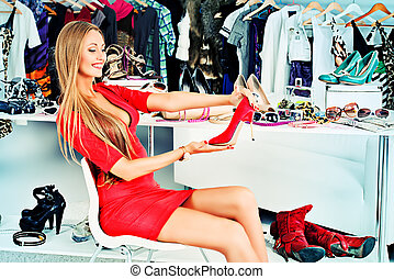 store for women - Fashionable girl choosing shoes in a...