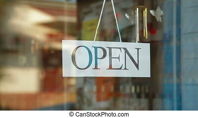 Store is Closed - Business owner turns sign from open to...