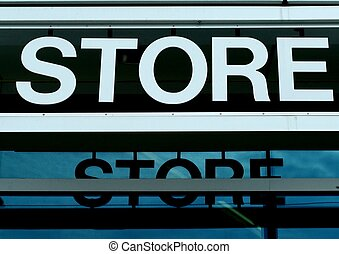 STORE SIGN - A white store sign against a black background