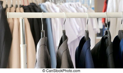 Store with hanger full of clothes - Dolly footage with pull...