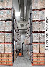 Storehouse - Storekeeper working in an industrial...