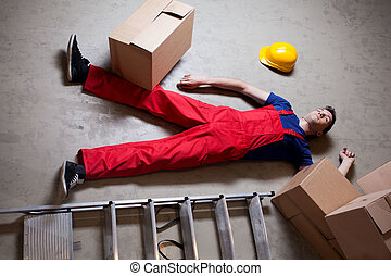Storekeeper lying on the floor after accident