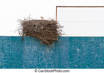 Stork nest over fronton wall - Stork nest on top of fronton...