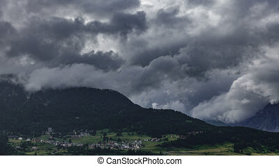 Storm and rain over mountain town - Time lapse of storm and...