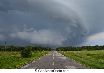The leading edge of a thunderstorm pushes across the southern Ontario landscape.