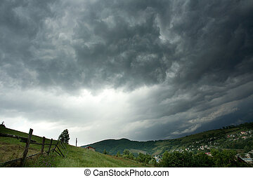 Storm clouds above a mountain village