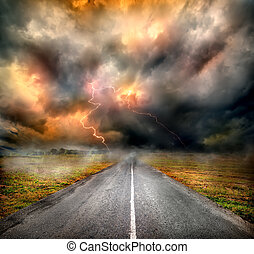 Storm clouds and lightning over highway