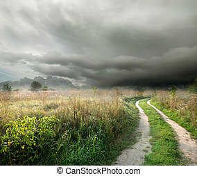 Storm clouds and road