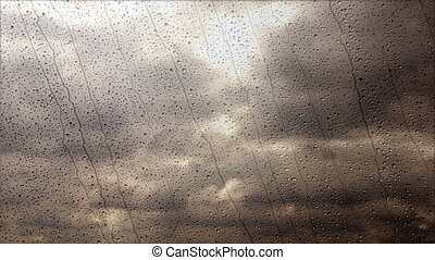 Storm clouds flying fast through the rainy window, wide angle view