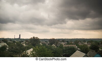 Storm Clouds In The Sky Moving Over The Houses In The City....