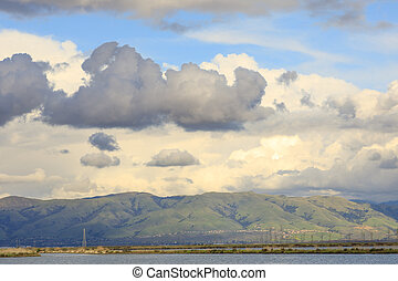 Storm clouds leaving the bay area over the Diablo Range.