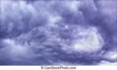 Seamlessly loopable footage of the dark stormy clouds