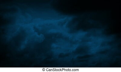 Storm Clouds Moving Over Night Sky - Huge clouds move across...