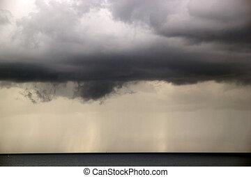 Storm clouds on the sea - Dark storm clouds on the sea
