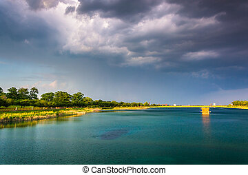 Storm clouds over Druid Lake, at Druid Hill Park in Baltimore, M